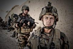Кабул, Афганистан - 11-ое марта 2011 Легионеры с оружиями во время военной операции в Афганистане Стоковое Фото