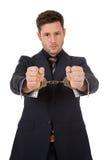 кавказец бизнесмена надевает наручники детеныши Стоковые Изображения RF