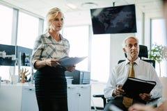 Кавказские коллеги дела в офисе смотря прочь Стоковое Фото