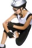 Кавказский женский думать велосипедиста Стоковое фото RF