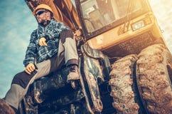 Кавказский оператор экскаватора стоковое фото rf