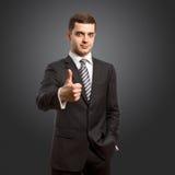 кавказский сделанный мужчина показывает наилучшим образом Стоковое фото RF