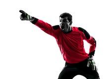 Кавказский человек голкипера футболиста указывая силуэт Стоковая Фотография
