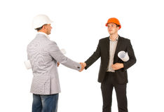 2 кавказских инженера среднего возраста тряся руки Стоковые Изображения