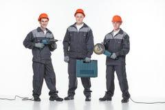 Кавказское молодое различное собрание работника физического труда изолированное на белизне Стоковые Фото
