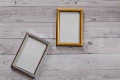2 кадра для фото на свете, винтажной деревянной предпосылке Стоковое Изображение