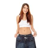 как потеряно много показывая женщине веса Стоковое фото RF