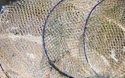 как премудрость людей рыболовства оборудования Крупный план белой сети fishnet внешней Стоковые Фото