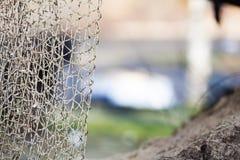 как премудрость людей рыболовства оборудования Крупный план белой сети fishnet внешней Стоковая Фотография RF
