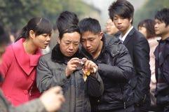 как раз смотрящ сфотографированные людей Стоковая Фотография RF
