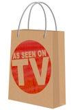 Как увидено на ТВ на хозяйственной сумке Kraft Стоковые Фотографии RF
