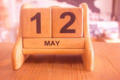 Календарь даты на двенадцатом может сделать деревянным шаблоном стоковые фотографии rf