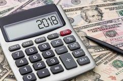 Калькулятор с деньгами - 2018 Стоковая Фотография