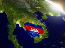 Камбоджа с флагом в восходящем солнце Стоковые Изображения