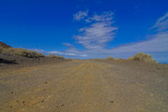 Каменистая дорога на вулканической пустыне Стоковые Фото