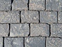 Каменная предпосылка текстуры мостоваой, камни габбро Стоковые Фото