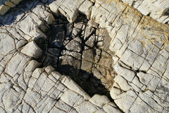 Каменная предпосылка крупного плана текстуры Стоковое Изображение RF