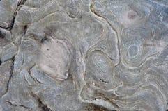 Каменная серая минеральная предпосылка текстуры Стоковые Фото