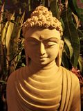 каменная скульптура лорда Будды закрыла вверх стоковая фотография rf