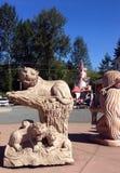 Каменная скульптура льва и новичков, Coombs, ДО РОЖДЕСТВА ХРИСТОВА Стоковое Фото