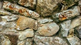 Каменная старая стена от огромных блоков Предпосылка камней концепция надежности Красивый текстурированный винтажный антиквариат Стоковое фото RF