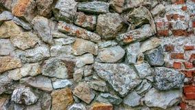 Каменная старая стена от огромных блоков Предпосылка камней Надежность концепции Пространство между камни заполнено с Стоковые Фотографии RF