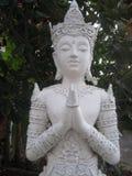 Каменная статуя божества стоковое фото