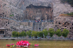 Каменная статуя Будды в Grottoes Longmen Стоковые Фото