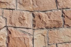 каменная стена в красном цвете стоковое фото