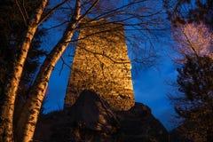 Каменная сторожевая башня на ноче Стоковые Изображения RF