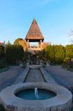 Каменные бассейн и фонтаны башни в саде Стоковое фото RF