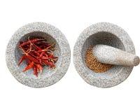 2 каменные миномет и пестик с chili, перчинкой внутрь Стоковые Фото