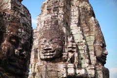 Каменные стороны на виске Bayon в Angkor Wat, Cambodi Стоковые Фото