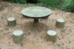 Каменные таблица и стулья в парке Coloane Стоковое Фото