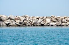 Каменный волнорез в Португалии Стоковое Изображение RF