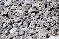 Каменный гравий на строительной площадке как предпосылка стоковые фото