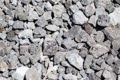 Каменный гравий на строительной площадке как предпосылка стоковая фотография