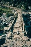 Каменный мост на треке базового лагеря Annapurna, Непал Стоковые Фотографии RF