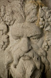 Каменный орнамент сада зеленого человека стоковая фотография rf