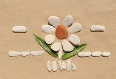 Каменный цветок на песке Стоковое Фото