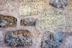 Камень белой и коричневой предпосылки вымощая камней цвета Стоковые Изображения RF