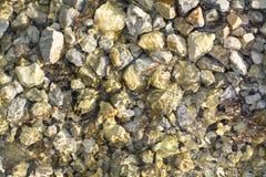 Камень в реке стоковые изображения
