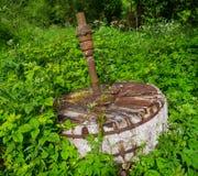 Камень жернова старый Стоковая Фотография