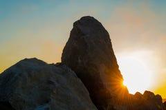 Камень и заход солнца Стоковая Фотография RF