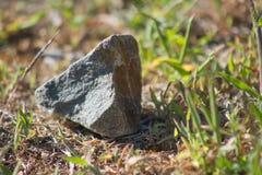 Камень на дороге стоковые изображения