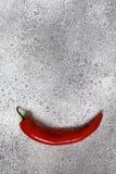 Камень предпосылки перца красного chili серый светлый Стоковое Изображение