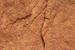 Камень трескает уникальный апельсин картины стоковая фотография