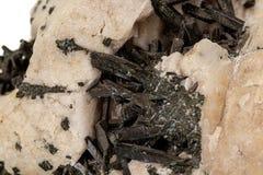 Камень Astrophyllite макроса минеральное на белой предпосылке стоковая фотография rf