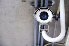 Камера слежения CCTV работая в доме стоковая фотография