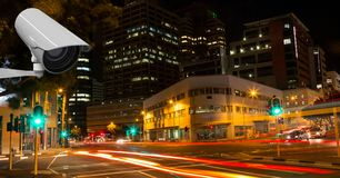 Камера CCTV против света отстает в городе на ноче Стоковые Изображения